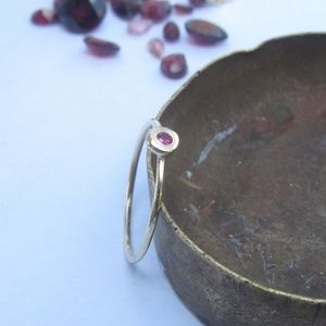 14K solid yellow gold ring, set with red ruby.